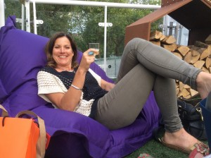 Gardening colleague Rosi, enjoying a glass of Ridgeview Estate bubbly at GROW show in London